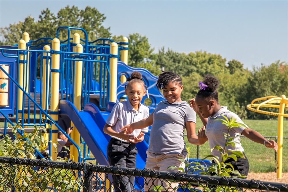 Trix Academy Scholars playing on a playground